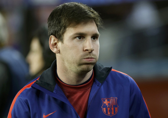 Barcelona's Lionel Messi reacts before his Champions League quarter-final second leg soccer match against Paris St Germain in Barcelona